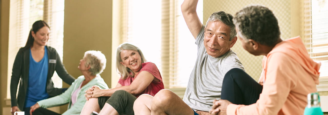 Residents stretch and work out together