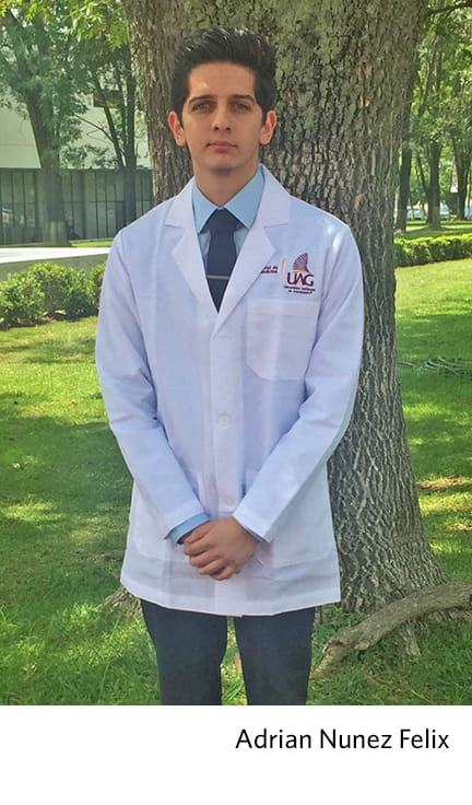 Adrian Nunez Felix poses in his white coat