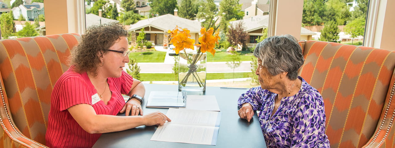 Vi at Highlands Ranch staff member talks to senior resident