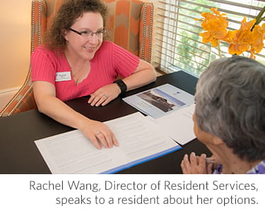 Vi at Highlands Ranch's director of resident services speaks to a resident about her options