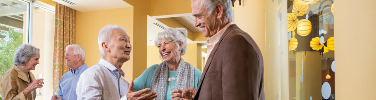 Senior Living Residents Mingle at a Community Function at Vi at La Jolla a Life Plan Community in San Diego