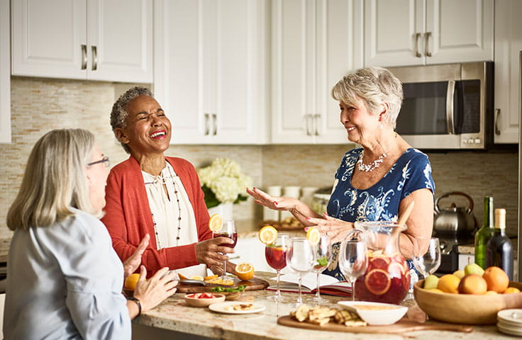 Vi Living, women laughing in kitchen
